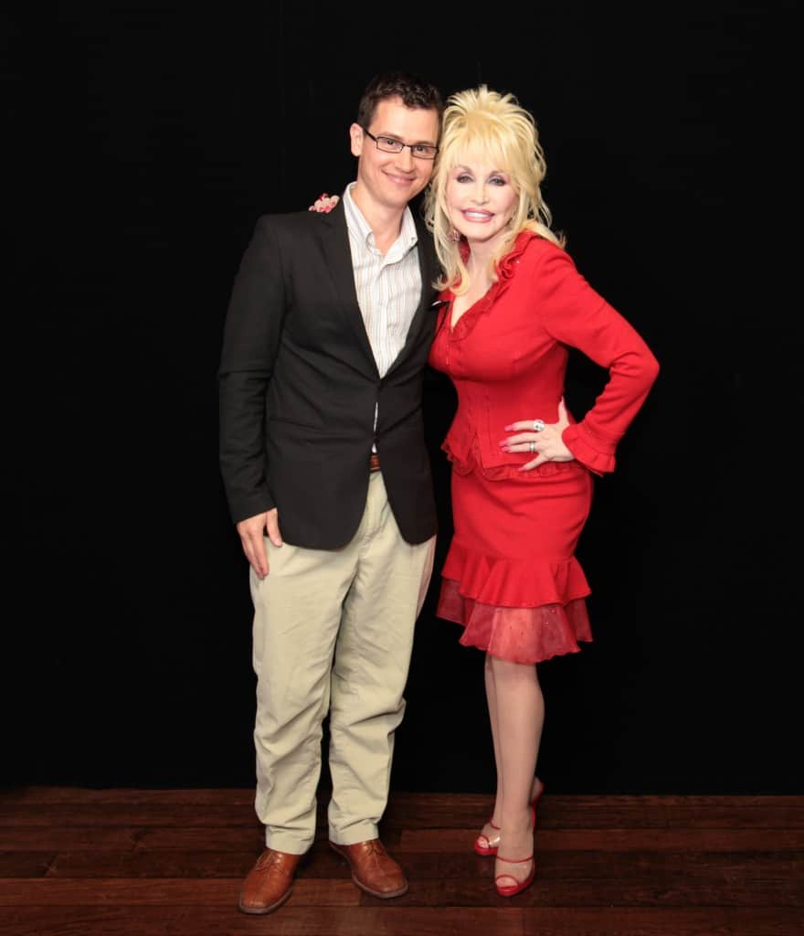 Event photographer, Julian Haber, posing with Dolly Parton