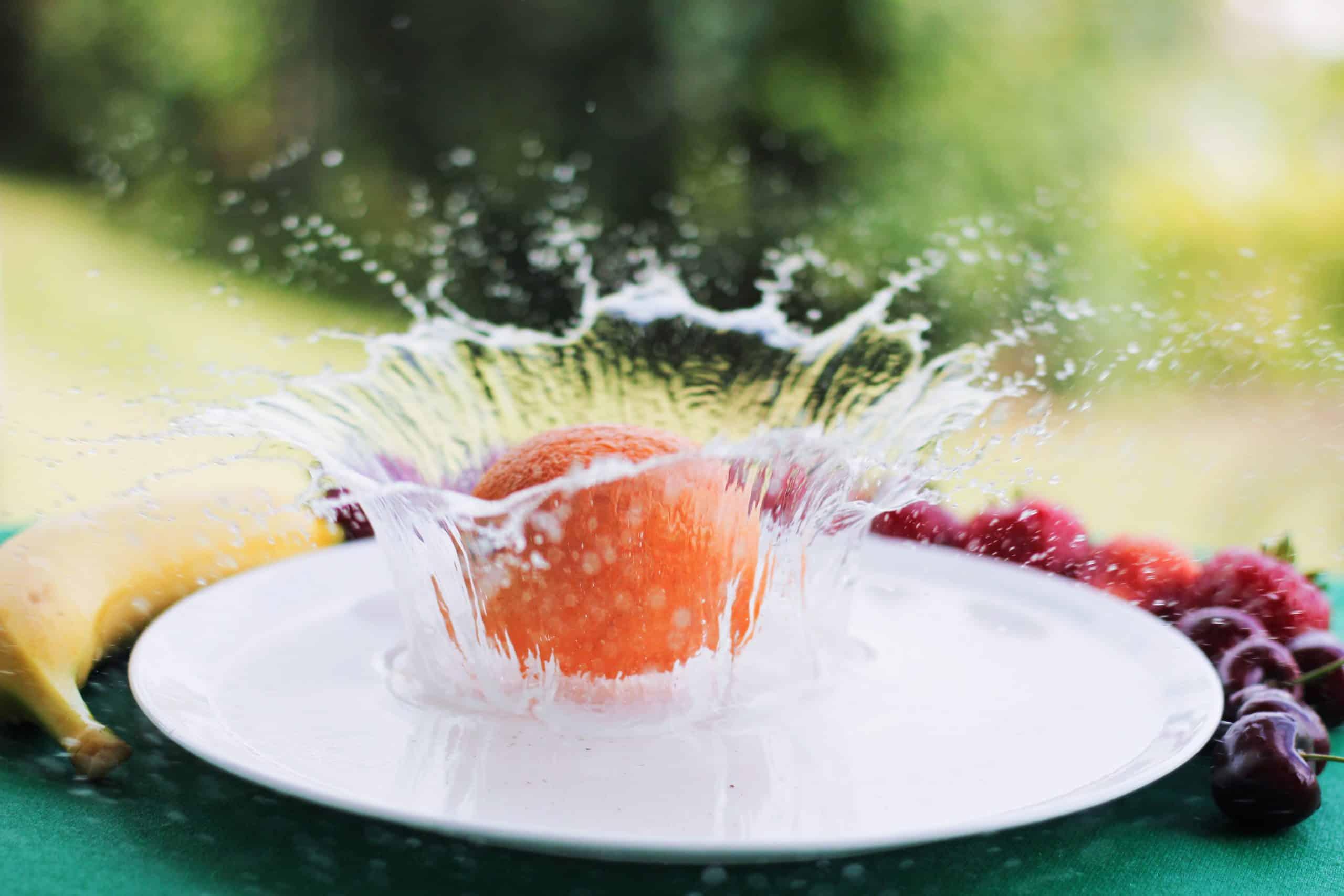 Orange splashing in water